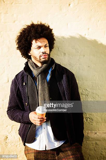 Hip Young Urban Man with Afro and coffee