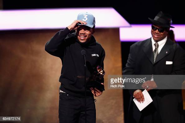 Hiphop artist Chance the Rapper accepts the Best Rap Performance award for 'No Problem' from Recording Academy Chair Emeritus/musician Jimmy Jam...