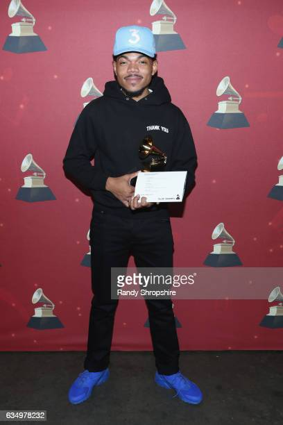 Hiphop artist Chance the Rapper poses with the Best Rap Performance award for 'No Problem' backstage at the Premiere Ceremony during the 59th GRAMMY...