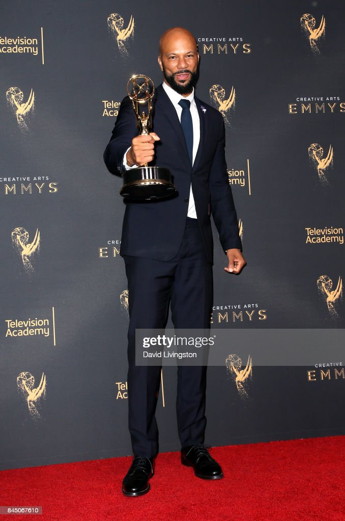 Hip-hop artist Common poses in the press room with the award for outstanding original music and lyrics for '13th Song Title: Letter to the Free' during the 2017 Creative Arts Emmy Awards at Microsoft Theater on September 9, 2017 in Los Angeles, California.