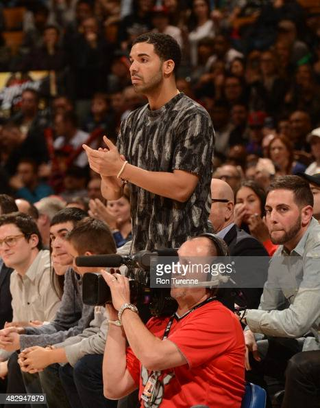 HipHop artist Drake attends a game between the Toronto Raptors and the Indiana Pacers on April 4 2014 at the Air Canada Centre in Toronto Ontario...