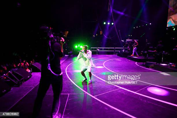 Hiphop artist Isaiah Rashad performs onstage during the Ice Cube Kendrick Lamar Snoop Dogg Schoolboy Q AbSoul Jay Rock concert at Staples Center on...