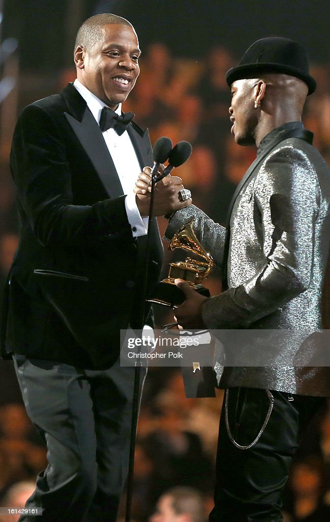 Hip-Hop artist Jay-Z and singer Ne-Yo onstage during the 55th Annual GRAMMY Awards at STAPLES Center on February 10, 2013 in Los Angeles, California.