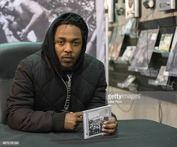 Hiphop artist Kendrick Lamar signs copies of his new album 'To Pimp A Butterfly' at Rough Trade NYC record store on March 20 2015 in New York City