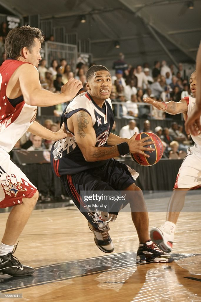Hiphop artist Nelly drives around coanchor of 'Access Hollywood' Tony Potts during the McDonald's NBA AllStar Celebrity Game Presented by 2K Sports...