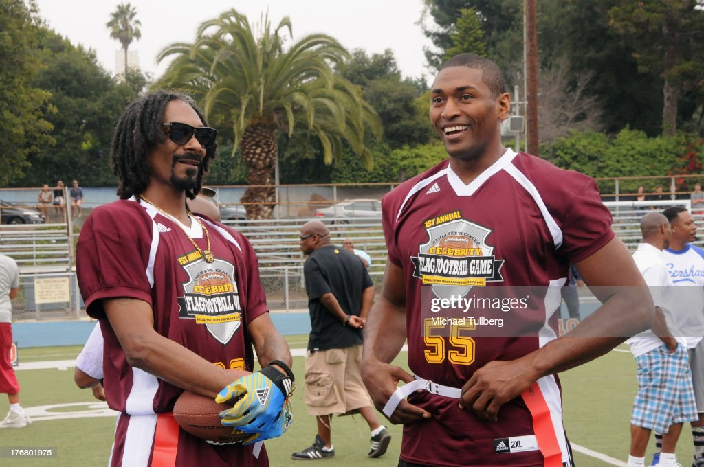 Hip-hop artist <a gi-track='captionPersonalityLinkClicked' href=/galleries/search?phrase=Snoop+Dogg&family=editorial&specificpeople=175943 ng-click='$event.stopPropagation()'>Snoop Dogg</a> and NBA player Metta World Peace chat at the First Annual Celebrity Flag Football Game on August 18, 2013 in Pacific Palisades, California.