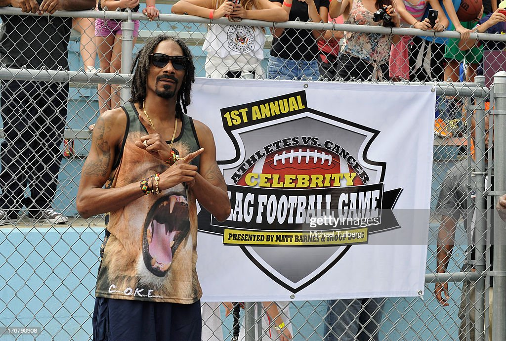 Hip-hop artist <a gi-track='captionPersonalityLinkClicked' href=/galleries/search?phrase=Snoop+Dogg&family=editorial&specificpeople=175943 ng-click='$event.stopPropagation()'>Snoop Dogg</a> attends the First Annual Celebrity Flag Football Game on August 18, 2013 in Pacific Palisades, California.
