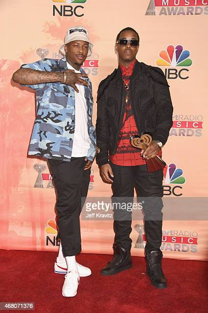 Hiphop artist YG and record producer Jeremih pose in the press room during the 2015 iHeartRadio Music Awards which broadcasted live on NBC from The...