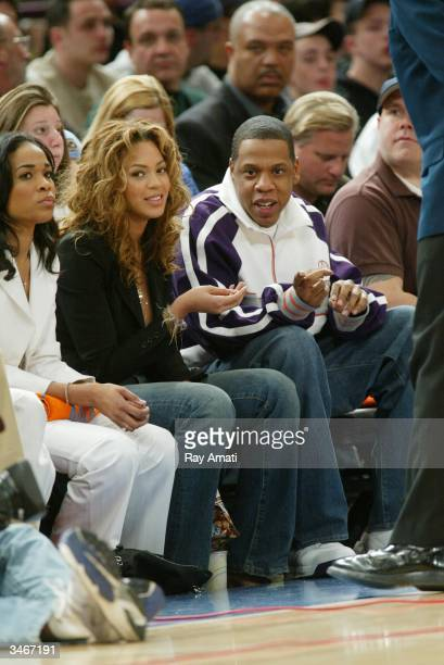 Hiphop artists Beyonce and JayZ sit courtside during Game four of the Eastern Conference Quarterfinals of the 2004 NBA Playoffs between the New York...