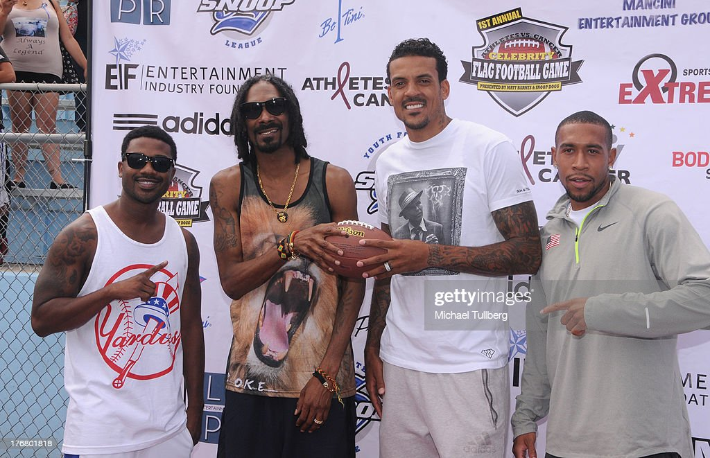 Hip-hop artists Ray-J and <a gi-track='captionPersonalityLinkClicked' href=/galleries/search?phrase=Snoop+Dogg&family=editorial&specificpeople=175943 ng-click='$event.stopPropagation()'>Snoop Dogg</a>, NBA player <a gi-track='captionPersonalityLinkClicked' href=/galleries/search?phrase=Matt+Barnes+-+Basketball+Player&family=editorial&specificpeople=202880 ng-click='$event.stopPropagation()'>Matt Barnes</a> and sprinter <a gi-track='captionPersonalityLinkClicked' href=/galleries/search?phrase=Bryshon+Nellum&family=editorial&specificpeople=2295658 ng-click='$event.stopPropagation()'>Bryshon Nellum</a> attend the First Annual Celebrity Flag Football Game on August 18, 2013 in Pacific Palisades, California.