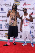 Hiphop artists Snoop Dogg and RayJ attend the First Annual Celebrity Flag Football Game on August 18 2013 in Pacific Palisades California