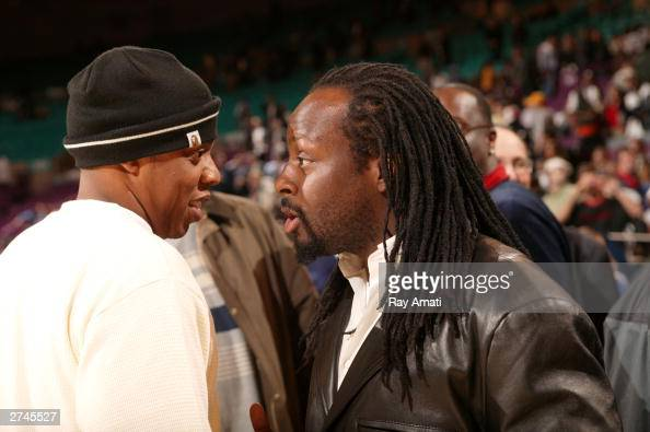 HipHop recording artists JayZ Wyclef Jean talk prior to the NBA game between the Los Angeles Lakers and the New York Knicks onNovember 19 2003 at...
