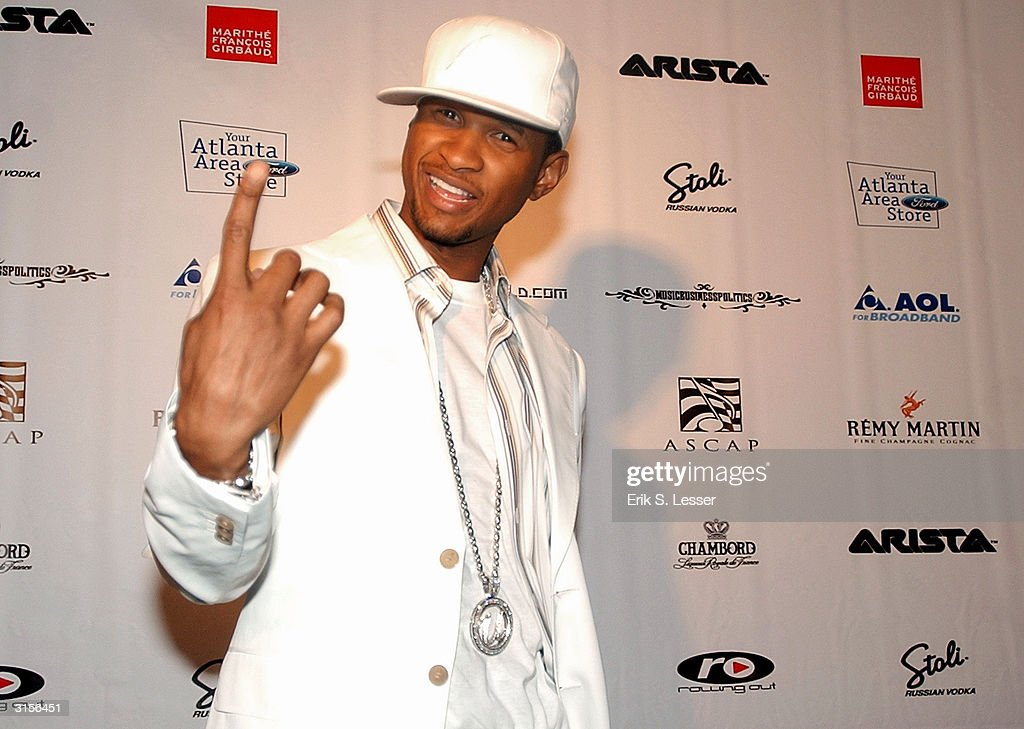 Hip-hop singer <a gi-track='captionPersonalityLinkClicked' href=/galleries/search?phrase=Usher+-+Singer&family=editorial&specificpeople=201477 ng-click='$event.stopPropagation()'>Usher</a> arrives at his 'Confessions' album release party at Compound club March 29, 2004, in Atlanta, Georgia. 'Confessions' is <a gi-track='captionPersonalityLinkClicked' href=/galleries/search?phrase=Usher+-+Singer&family=editorial&specificpeople=201477 ng-click='$event.stopPropagation()'>Usher</a>'s fifth album.