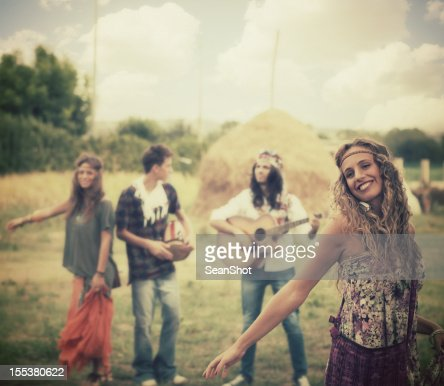 Hippie girl dancing with her friends.