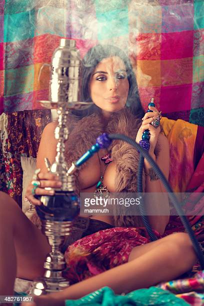hippie girl smoking water pipe
