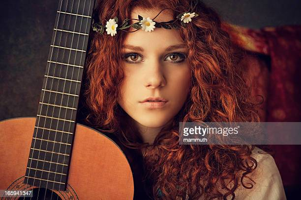 hippie girl with acoustic guitar