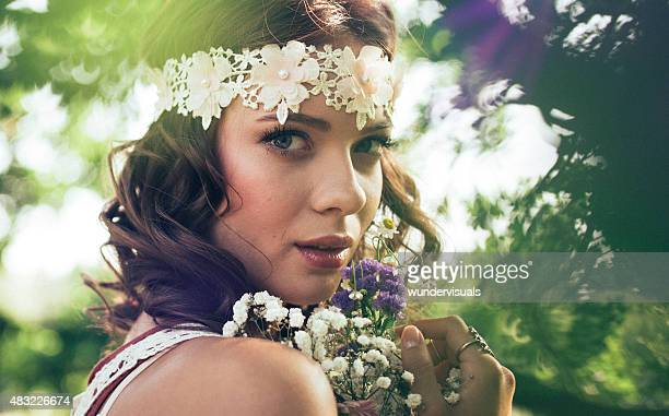 Hippie girl with wild flowers in nature
