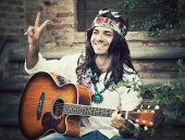 Hippie showing peace gesture. 1970s style.