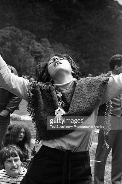 A hippie woman dances at a summer solstice celebration at Golden Gate Park in San Francisco