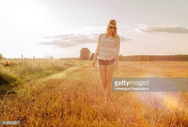 Hippie Woman Walking Over Meadow
