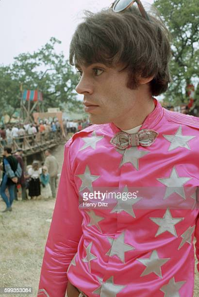 A hippiemod boy wears a pink satin shirt covered with silver stars