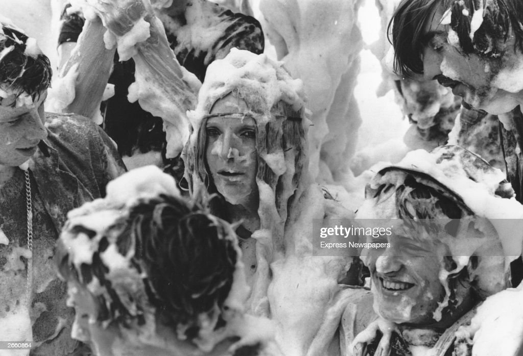 Hippies at the Isle of Wight pop festival having a communal foam bath