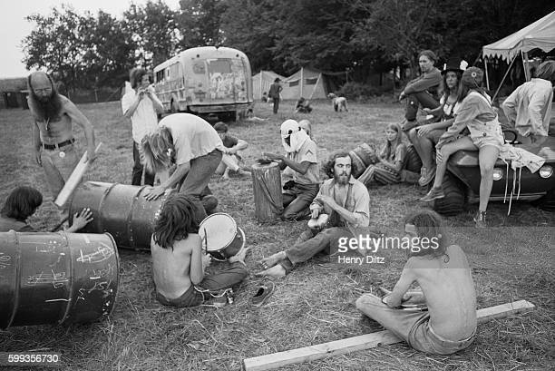 Hippies drum together as they hang out before the start of the free Woodstock Music and Art Fair The festival took place on Max Yasgur's dairy farm...