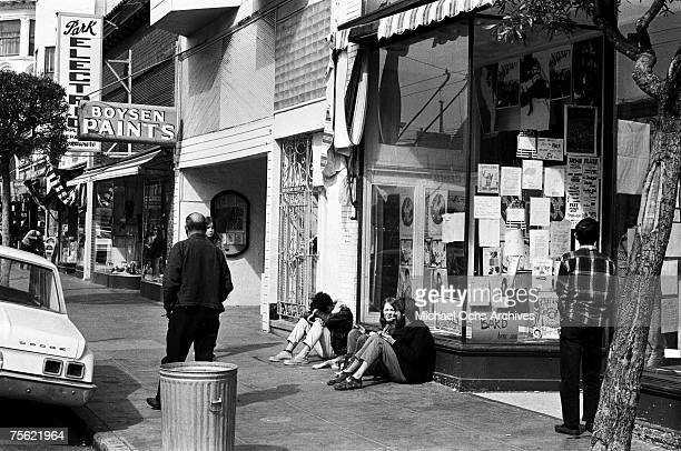 Hippies lounge in front of a local establishment in the HaightAshbury disctrict in San Francisco California in the early summer 1967