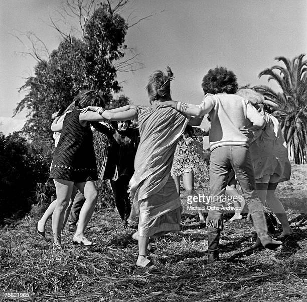 Hippies or 'freaks' as they prefer to be called dance in an open field in Los Angeles California in summer 1967