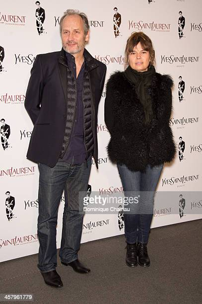 Hippolyte Girardot and his wife Kristina Larsen attend the 'Yves Saint Laurent' Paris Premiere at Cinema UGC Normandie on December 19 2013 in Paris...