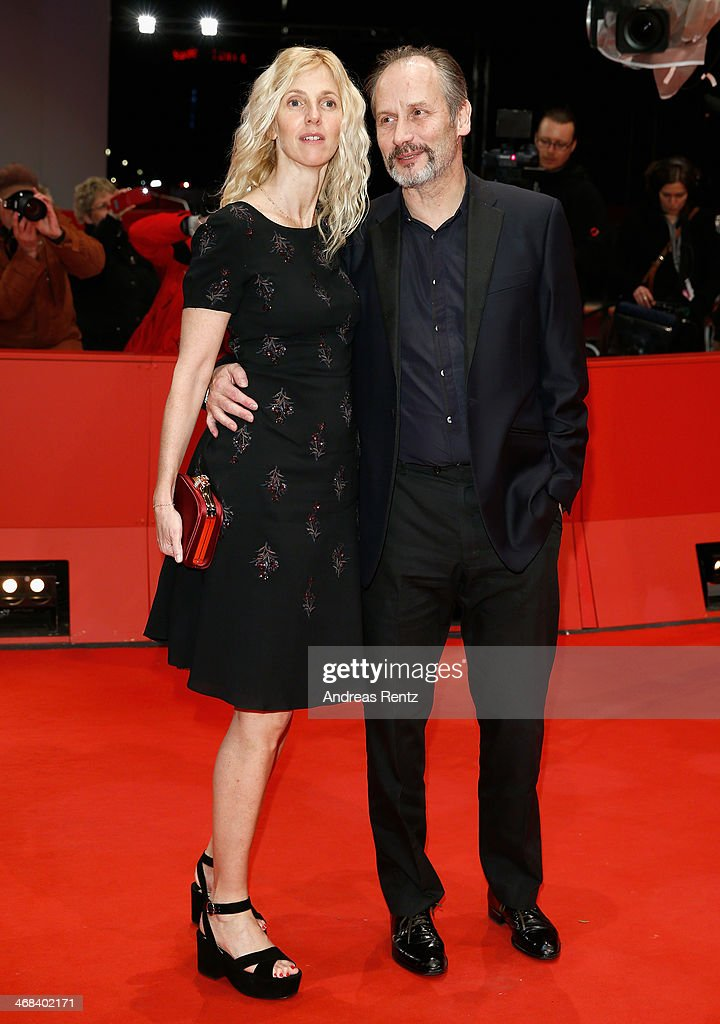 Hippolyte Girardot and Sandrine Kiberlain attend the 'Life of Riley' (Aimer, boire et chanter) premiere during 64th Berlinale International Film Festival at Berlinale Palast on February 10, 2014 in Berlin, Germany.