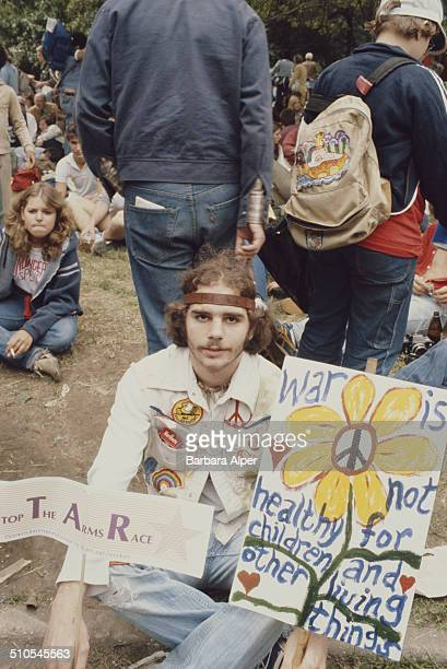 A hippy at a antinuclear rally in Central Park New York City 12th June 1982