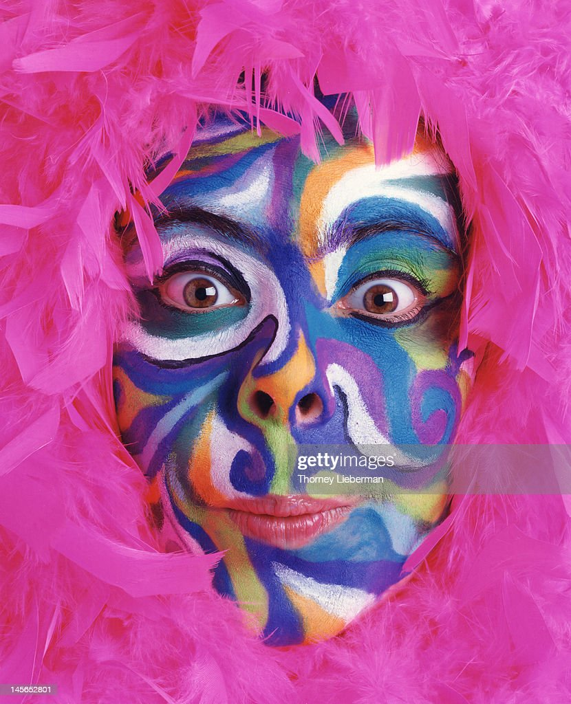 Hippy chick with painted face : Stock Photo