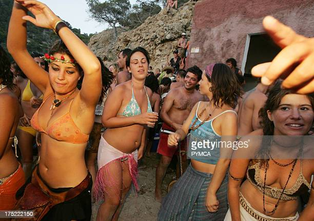 Hippy girls dancing Sunset beach party Benirras Beach Ibiza July 2006