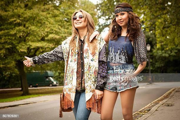 Hippy girls hitch-hiking