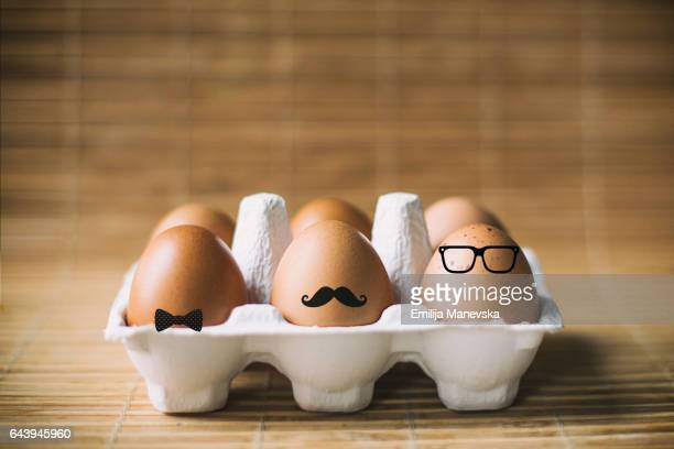 hipster Easter eggs in carton