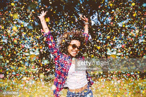 Hipster enjoying confetti