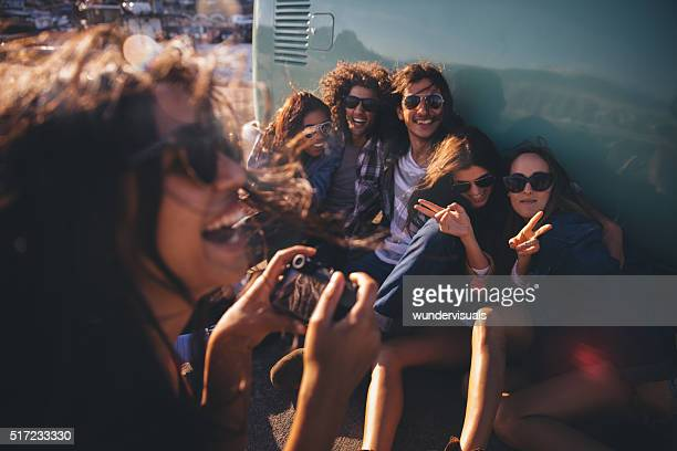 Hipster friends having fun with pictures on road trip