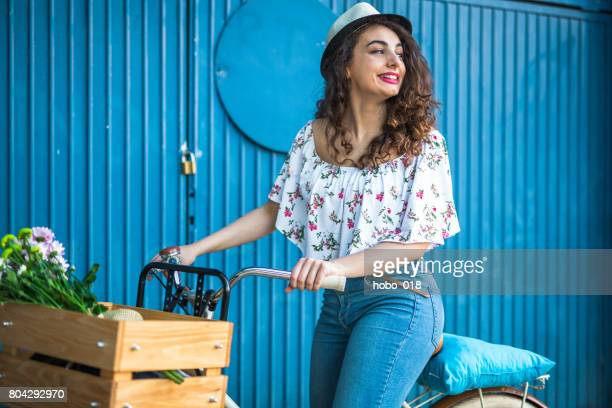 Hipster girl and her fancy bicycle