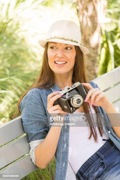 Hipster girl and her retro camera