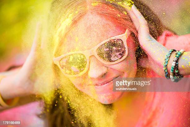 Hipster girl at Holi Festival with sunglasses