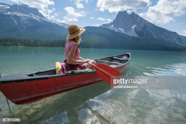 Hipster girl canoeing on Emerald lake, Canada