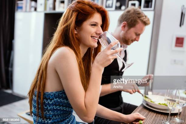 Hipster girl holding a glass of water.