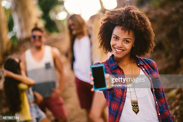 Hipster girl is holding a smartphone