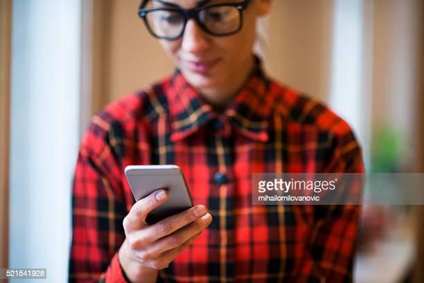 Hipster girl using phone