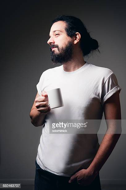 Hipster Guy Enjoying A Cup Of Coffee