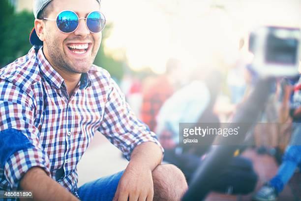Hipster guy taking selfies.