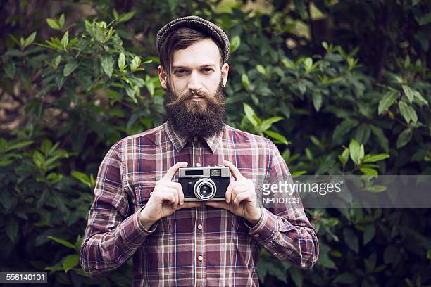 Hipster holding a camera