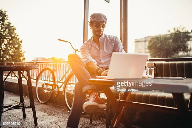 Hipster in cafe on laptop