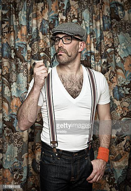 Hipster in glasses smoking a pipe